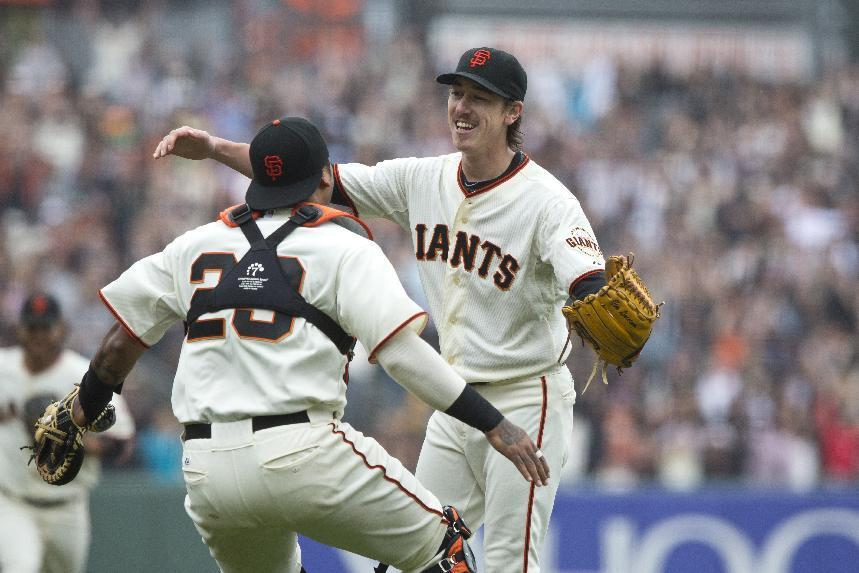 Tim Lincecum of the San Francisco Giants celebrates with Hector Sanchez after the game at AT&T Park on June 25, 2014 in San Francisco, California (AFP Photo/Jason O. Watson)