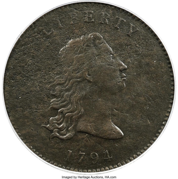 """This undated photo provided by Heritage Auctions shows the front of a piece of copper that was struck by the U.S. Mint in Philadelphia in 1794 and was a prototype for the fledgling nation's money. The item, which is known as the """"No Stars Flowing Hair Dollar,"""" is owned by businessman and Texas Rangers co-chairman Bob Simpson and will go up for auction at Heritage Auctions in Dallas on Friday, April 23, 2021. (Emily Clements/Heritage Auctions via AP)"""