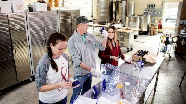 PHOTO: Distillery employees make hand sanitizer at the Eight Oaks Farm Distillery in New Tripoli, Pa., March 16, 2020. The distillery is temporarily converting to producing the suddenly hard-to-find, gooey, alcohol-based disinfectant. (Matt Rourke/AP)