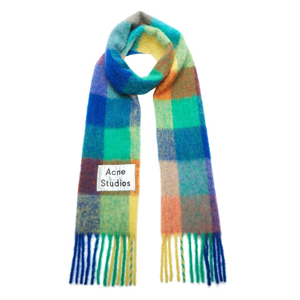 <p>Give the gift of warmth (and fashion) with this colorful, oversized plaid scarf made from a blend of wool, mohair, and alpaca. </p>