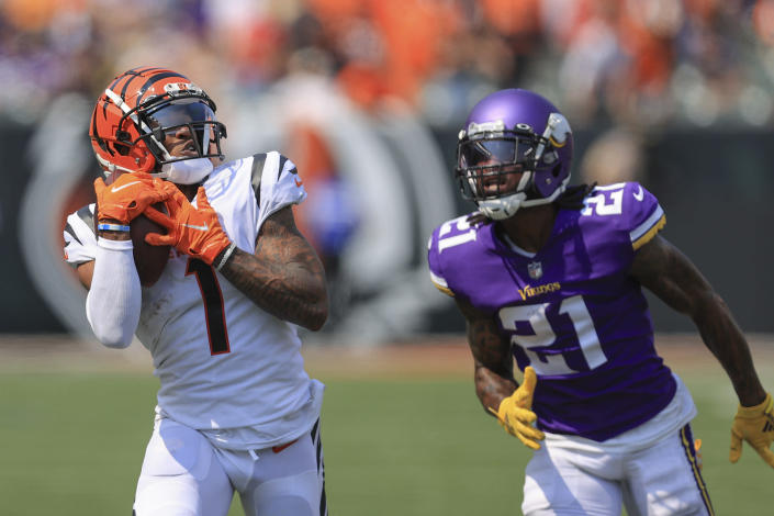 Cincinnati Bengals wide receiver Ja'Marr Chase (1) makes a catch past Minnesota Vikings defensive back Bashaud Breeland (21) and takes it in for a touchdown in the first half of an NFL football game, Sunday, Sept. 12, 2021, in Cincinnati. (AP Photo/Aaron Doster)