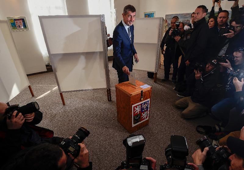 Czech billionaire Andrej Babis, chairman of the anti-migrant ANO movement, casts his ballot at a polling station near Prague in an election that could see the 'Czech Trump' take power. (AFP Photo/MICHAL CIZEK)