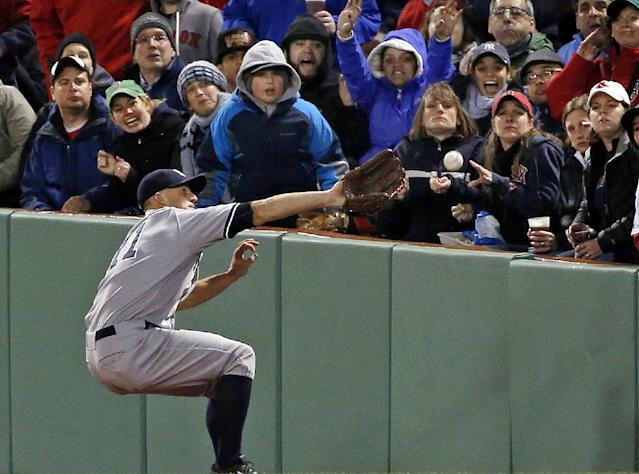 New York Yankees right fielder Brett Gardner cannot make the catch on a ground-rule double by Boston Red Sox's Mike Napoli during the third inning of a baseball game at Fenway Park in Boston, Wednesday, April 23, 2014. Dustin Pedroia scored on the hit. (AP Photo/Elise Amendola)