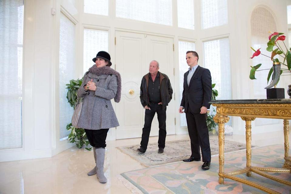 From left, Laura and Jack Sommer stand with their realtor Craig Tann in the entryway of their home in the Spanish Trail neighborhood of Las Vegas on Thursday, Dec. 12, 2013. Jack Sommer, a casino owner-turned-commercial developer, is asking $7.85 million to sell the home, and he's willing to accept the online currency bitcoin for the deal. (AP Photo/Las Vegas Review-Journal, Alex Federowicz)