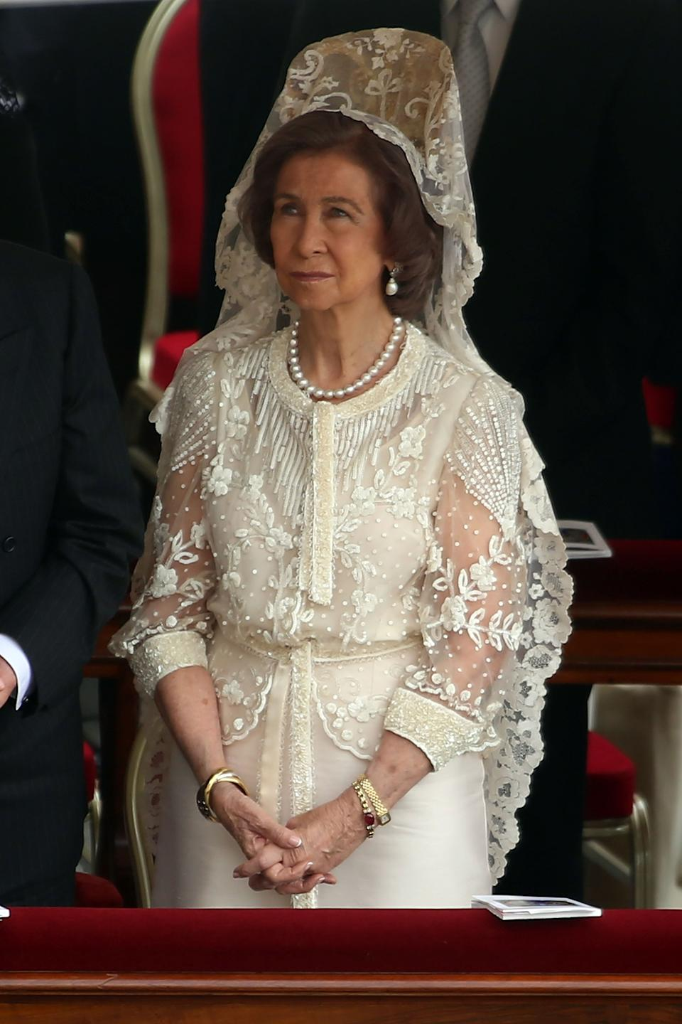 Queen Sofia of Spain wears white in Vatican City. (Photo by Franco Origlia/Getty Images)