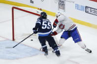 Montreal Canadiens' Jake Evans (71) scores an empty-net goal as Winnipeg Jets' Mark Scheifele (55) defends during the third period of Game 1 of an NHL hockey Stanley Cup second-round playoff series Wednesday, June 2, 2021, in Winnipeg, Manitoba. (John Woods/The Canadian Press via AP)