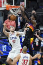 Phoenix Suns center Deandre Ayton, top right, scores over Los Angeles Clippers center Ivica Zubac during the second half of Game 2 of the NBA basketball Western Conference Finals, Tuesday, June 22, 2021, in Phoenix. (AP Photo/Matt York)