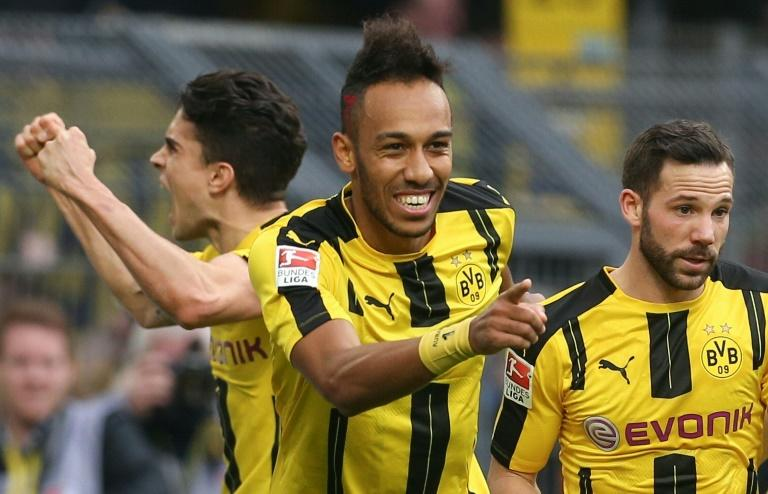 Dortmund's forward Pierre-Emerick Aubameyang (C) celebrates scoring the 3-1 with defender Marc Bartra (L) and midfielder Gonzalo Castro during the German First division Bundesliga football match against Bayer 04 Leverkusen March 4, 2017
