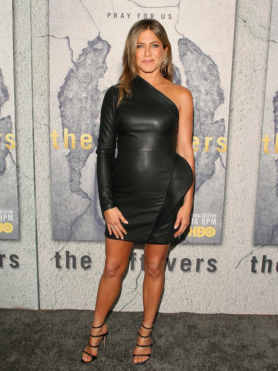 """Aniston's asymmetrical leather dress by Brandon Maxwell was an out-of-the-box fashion moment at """"The Leftovers"""" premiere in 2017. (Photo by JB Lacroix/WireImage)"""