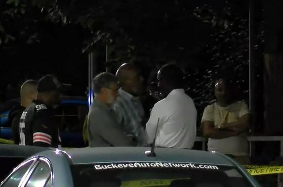 Cleveland Mayor Frank Jackson, third from left, in grey shirt, with arms folded, at scene of fatal shooting of his grandson Frank Q. Jackson on night of September 19, 2021. / Credit: WOIO-TV