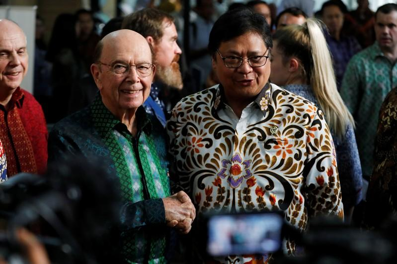 U.S. Commerce Secretary Wilbur Ross shakes hands with Indonesia's Chief Economic Minister Airlangga Hartarto after their meeting in Jakarta