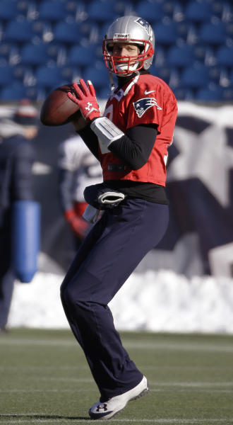 New England Patriots quarterback Tom Brady (12) sets up to throw a pass during a stretching and drills session before practice begins at the NFL football team's facility in Foxborough, Mass., Wednesday, Dec. 18, 2013. The Patriots play the Baltimore Ravens Sunday in Maryland. (AP Photo/Stephan Savoia)