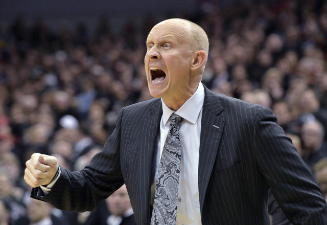 Louisville coach Chris Mack argues a call during the first half of an NCAA college basketball game against Duke in Louisville, Ky., Tuesday, Feb. 12, 2019. (AP Photo/Timothy D. Easley)