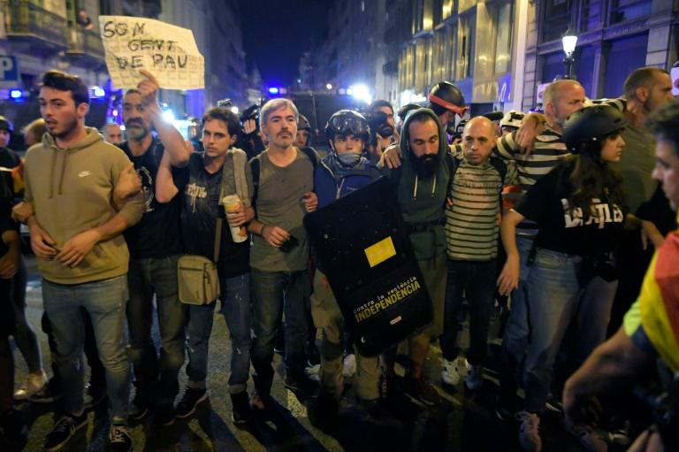 Protesters formed a human chain between police and a sit-in, as the tourist hotspot reels from days of clashes following the jailing of separatist leaders