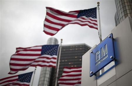 Flags wave behind a General Motors Corp sign in downtown in Detroit