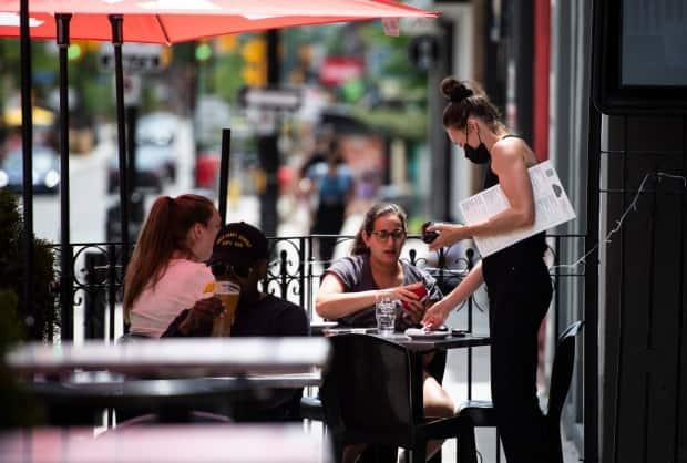 While some businesses like restaurants are allowed to be partially open in Ottawa, others like hair salons are still closed. (Justin Tang/The Canadian Press - image credit)