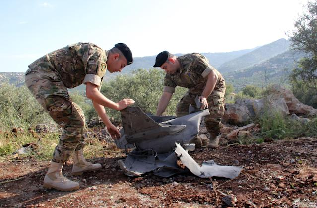 "<p>Lebanese soldiers inspect remains of a surface to air missile that landed in the southern Lebanese village of Hebarieh, early on May 10, 2018. Dozens of rockets were fired from Syria on the Israeli-occupied Golan overnight, a war monitor said, without confirming Israeli reports they were fired by Iranian forces. ""After the first Israeli bombardment on the town of Baath, dozens of rockets were launched from Quneitra and the southwest of the adjacent Damascus countryside on the occupied part of the Golan Heights,"" the Syrian Observatory for Human Rights said. Israel said it was in retaliation for Iranian rocket fire from the Quneitra area that it launched missile strikes on Iranian military infrastructure in Syria. (Photo: Ali Dia/ FP/Getty Images) </p>"