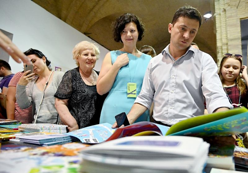 """Newly elected Ukrainian President Volodymyr Zelensky at a book fair in Kiev tells AFP that his new job """"has been a bit of a shock, there's a lot of work"""" (AFP Photo/Sergei SUPINSKY)"""