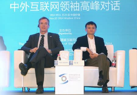 Qualcomm Chairman and CEO Paul Jacobs (L) sits next to Alibaba Group Executive Chairman Jack Ma during a meeting at the World Internet Conference (WIC) in Wuzhen town, Zhejiang province November 20, 2014. REUTERS/Stringer