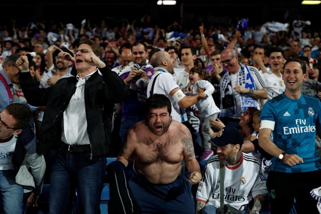 Soccer Football - Real Madrid fans watch the Champions League Final - Madrid, Spain - May 26, 2018 Real Madrid fans celebrate their third goal while inside the Santiago Bernabeu REUTERS/Javier Barbancho