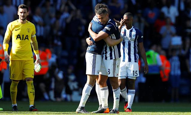 Goalscorer Jake Livermore celebrates with team-mates after West Brom's victory over Spurs.