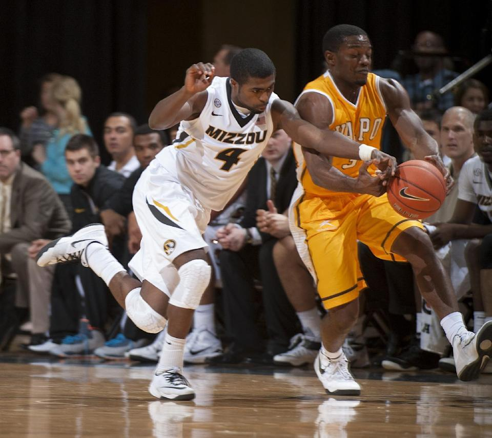 Missouri's Tramaine Isabell, left, knocks the ball away from Valparaiso's Max Joseph, right, during the first half of an NCAA college basketball game Sunday, Nov. 16, 2014, in Columbia, Mo. (AP Photo/L.G. Patterson)
