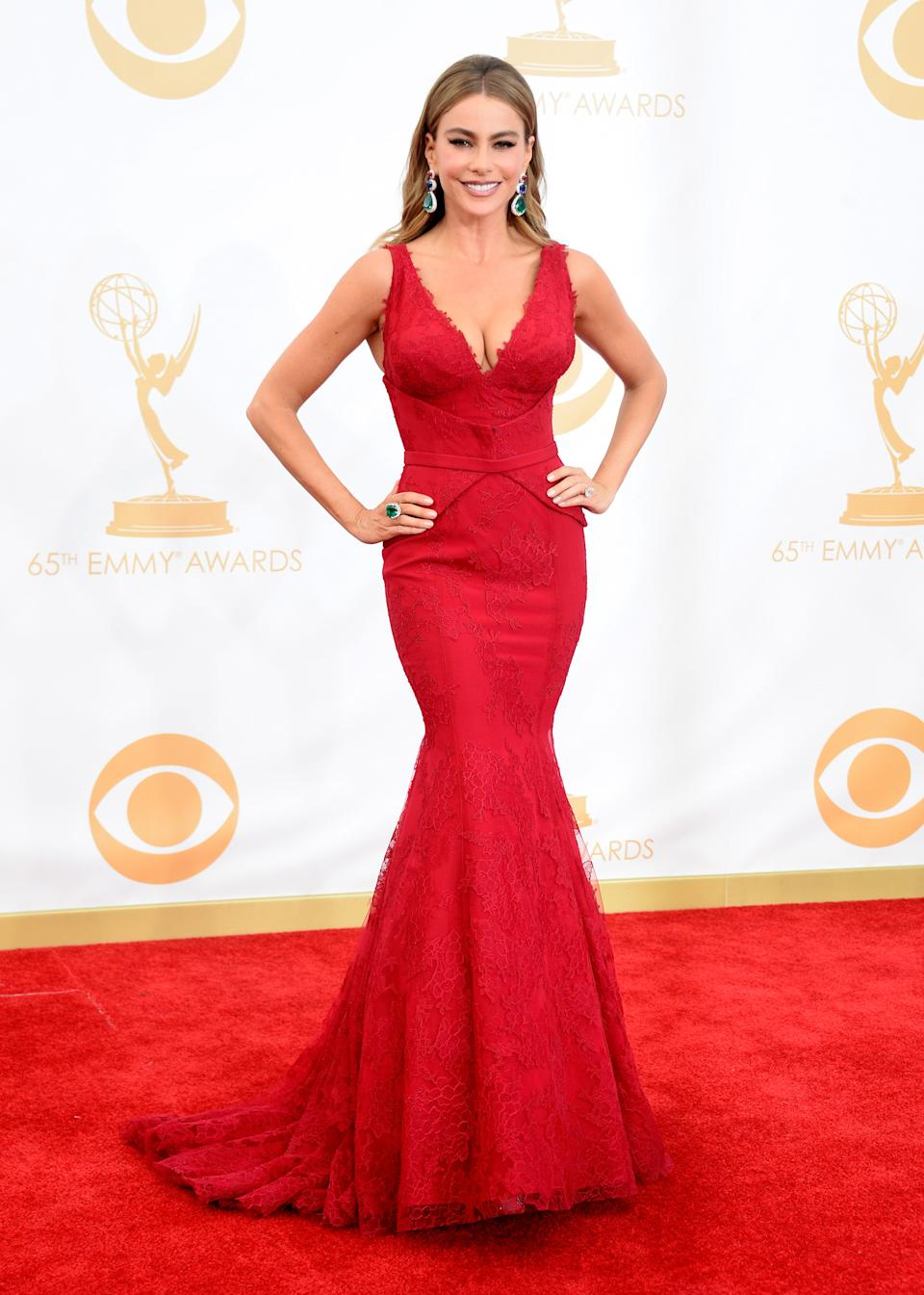 """<p>The """"Modern Family"""" star looked like a modern-day Sophia Loren in a crimson look by Vera Wang at the 2013 Emmy Awards. (Image via Getty Images).</p>"""
