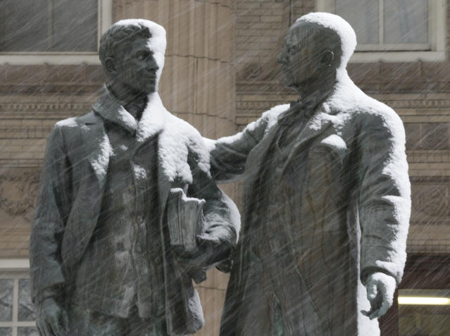 Snow begins to gathers on a statue on the University of Kansas campus in Lawrence, Kan., Saturday, March 23, 2013. The area is under a winter storm warning. (AP Photo/Orlin Wagner)