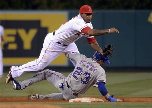 Texas Rangers' Craig Gentry is forced out at second as Los Angeles Angels second baseman Howard Kendrick throws out Ian Kinsler at first during the third inning of their baseball game against the Los Angeles Angels, Saturday, June 2, 2012, in Anaheim, Calif. (AP Photo/Mark J. Terrill)