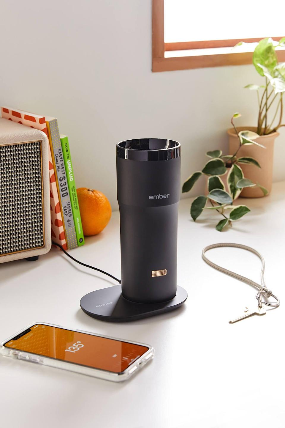 """<p>Make sure his coffee's at the perfect temperature all day long with the <a href=""""https://www.popsugar.com/buy/Ember-Travel-Mug-545915?p_name=Ember%20Travel%20Mug&retailer=urbanoutfitters.com&pid=545915&price=180&evar1=geek%3Aus&evar9=36026397&evar98=https%3A%2F%2Fwww.popsugar.com%2Ftech%2Fphoto-gallery%2F36026397%2Fimage%2F47175965%2FEmber-Travel-Mug&list1=gifts%2Cgift%20guide%2Cdigital%20life%2Ctech%20gifts%2Cgifts%20for%20men&prop13=mobile&pdata=1"""" class=""""link rapid-noclick-resp"""" rel=""""nofollow noopener"""" target=""""_blank"""" data-ylk=""""slk:Ember Travel Mug"""">Ember Travel Mug</a> ($180).</p>"""