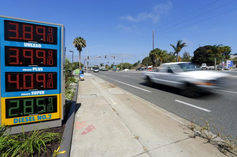 The current price of gasoline is shown on a gas station sign in Encinitas