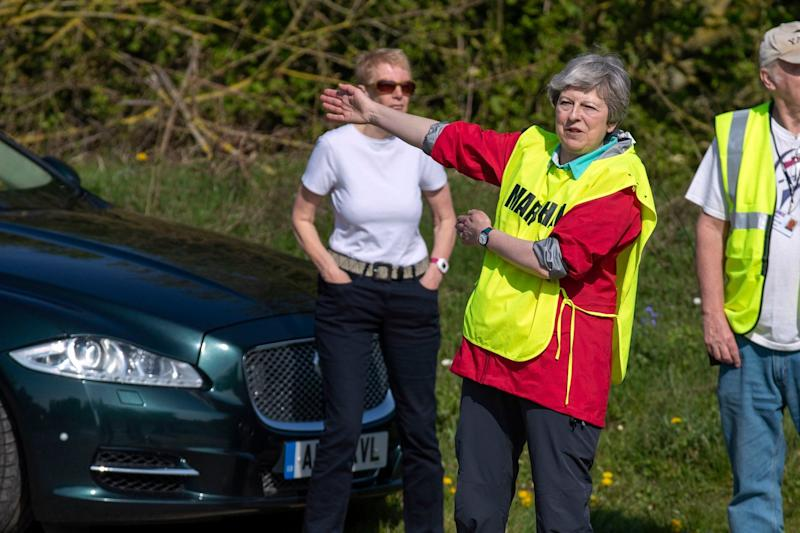 Mrs May directed runners in Maidenhead's Easter 10 (PA)