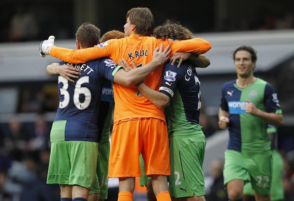 Newcastle United players celebrate after their English Premier League match against Tottenham Hotspur, at White Hart Lane in north London, on October 26, 2014 (AFP Photo/Ian Kington)