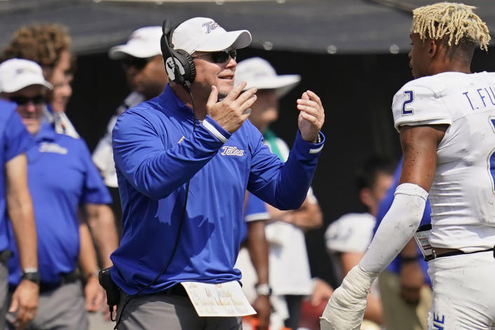 Tulsa head coach Philip Montgomery gestures to his team during a timeout in the second half of an NCAA college football game against Oklahoma State, Saturday, Sept. 11, 2021, in Stillwater, Okla. (AP Photo/Sue Ogrocki)