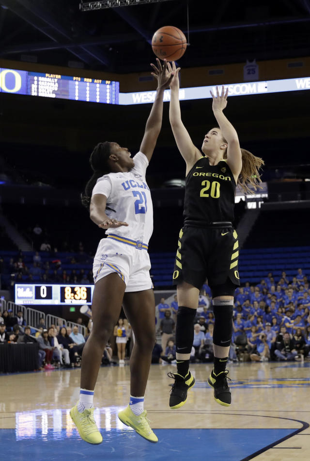 Oregon guard Sabrina Ionescu (20) shoots over UCLA forward Michaela Onyenwere (21) during the first half of an NCAA college basketball game Sunday, Jan. 13, 2019, in Los Angeles. (AP Photo/Marcio Jose Sanchez)
