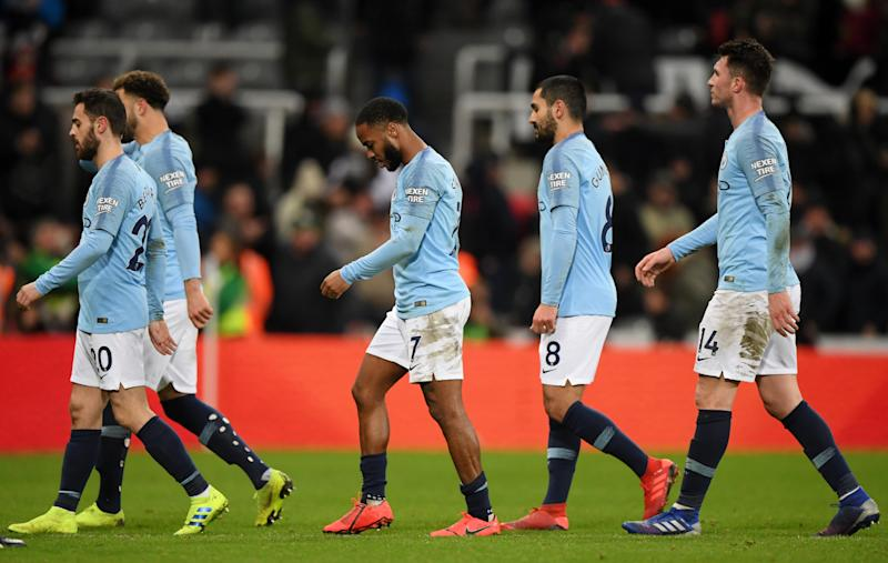 Manchester City players trudge off at the final whistle