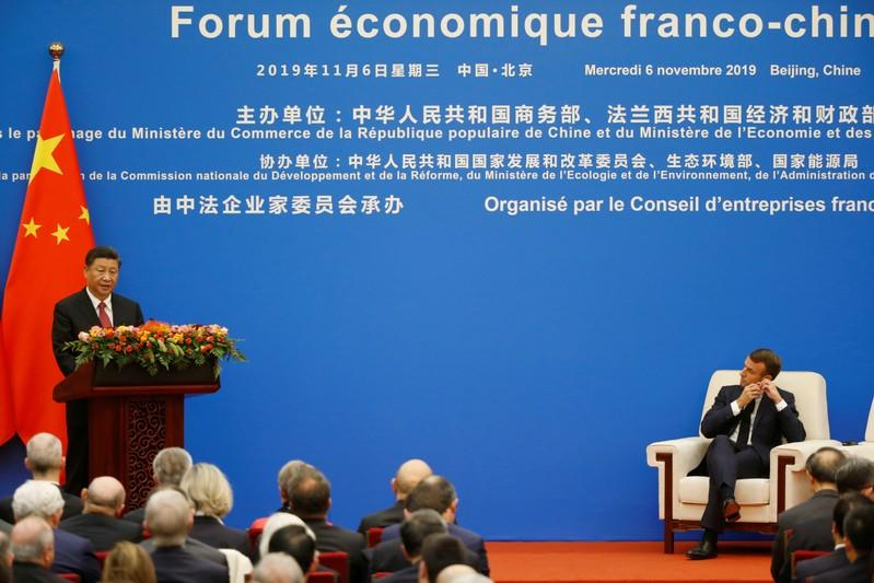French President Emmanuel Macron and Chinese President Xi Jinping attend a China-France Economic Forum at the Great Hall of the People in Beijing