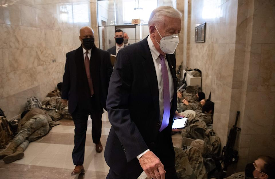 House Majority Leader Steny Hoyer, Democrat of Maryland, walks past members of the National Guard as he arrives at the Capitol on 13 January, 2021 (AFP via Getty Images)