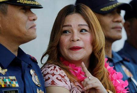 Barangay Bagong Silangan district chief Crisell Beltran talks to a police officer during a flag-raising ceremony at Batasan Police Station 6 in Quezon City, Metro Manila, Philippines December 4, 2017. REUTERS/Erik De Castro