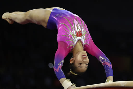 Tang Xijing of China performs on the vault in the women's all-around final at the Gymnastics World Championships in Stuttgart, Germany, Thursday, Oct. 10, 2019. (AP Photo/Matthias Schrader)