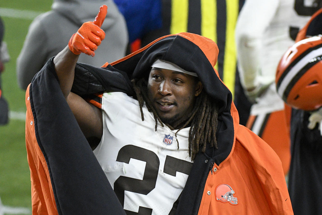 Cleveland Browns running back Kareem Hunt (27) celebrates on the sideline during the first half of an NFL wild-card playoff football game against the Pittsburgh Steelers in Pittsburgh, Sunday, Jan. 10, 2021. (AP Photo/Don Wright)