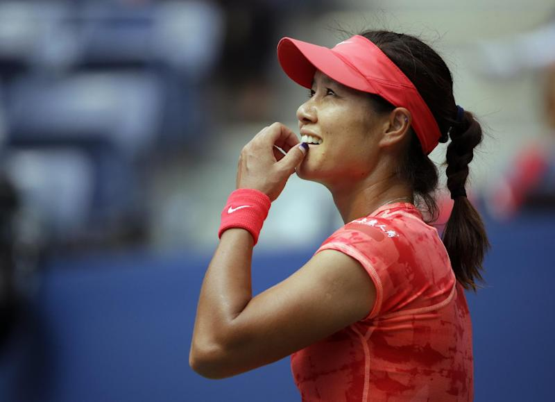 China's Li Na reacts to an instant replay of a shot against Sofia Arvidsson, of Sweden, during the second round of the 2013 U.S. Open tennis tournament, Wednesday, Aug. 28, 2013, in New York. (AP Photo/Kathy Willens)