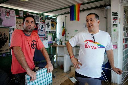 Gay rights activists Isbel Diaz Torres (R) and Jimmy Roque Martinez, speak during an interview in Havana, Cuba, May 7, 2019. REUTERS/Alexandre Meneghini