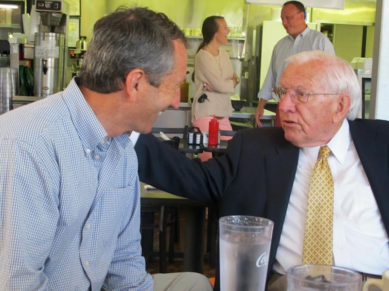 Mark Sanford, left, chats with former S.C. Gov. Jim Edwards during a campaign stop at a diner in Mount Pleasant, S.C., on Monday, May 6, 2012. Sanford faces Elizabeth Colbert Busch, the sister of comedian Stephen Colbert, in a special congressional election in the state's 1st District on Tuesday. Edwards was campaigning for Sanford on Monday. (AP Photo/Bruce Smith)