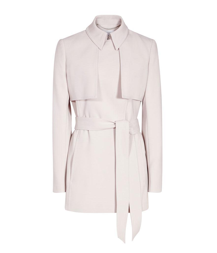 """<p>Lester Cropped Trench Coat, $465,<a rel=""""nofollow noopener"""" href=""""https://www.reiss.com/us/p/cropped-trench-coat-womens-lester-in-chiffon/?category_id=1124"""" target=""""_blank"""" data-ylk=""""slk:reiss.com"""" class=""""link rapid-noclick-resp""""> reiss.com</a> </p>"""