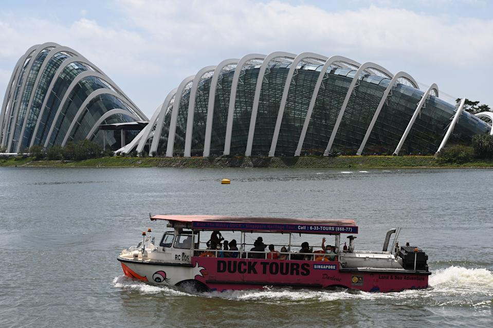 Tourists ride on an amphibious