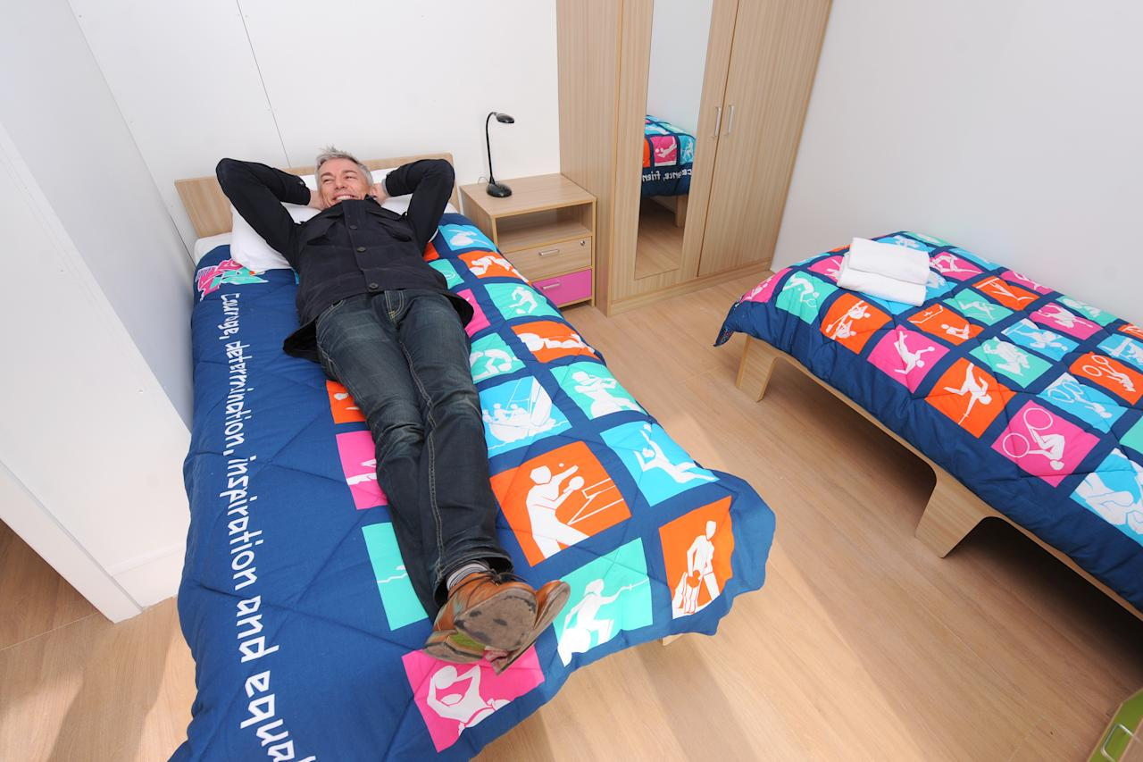 Former Olympic Athlete Jonathan Edwards, who is now Chair of the London Organising Committee of the Olympic Games' Athletes Committee, pictured in a completed apartment bedroom in the Athlete's Village at the Olympic Park in Stratford on March 15, 2012 in London, England. (Photo By Dominic Lipinski - WPA Pool/Getty Images)