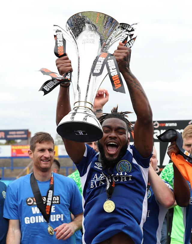 Soccer Football - National League - Macclesfield Town v Dagenham & Redbridge - Moss Rose, Macclesfield, Britain - April 28, 2018 Macclesfield Town's Tyrone Marsh celebrates winning the National League as he lifts the trophy Action Images/Peter Cziborra