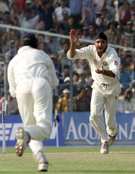 Harbhajan Singh of India claims the wicket of Shane Warne of Australia, to complete a hat trick, during day one of the 2nd Test between India and Australia played at Eden Gardens, Calcutta, India. X DIGITAL IMAGE  Mandatory Credit: Hamish Blair/ALLSPORT