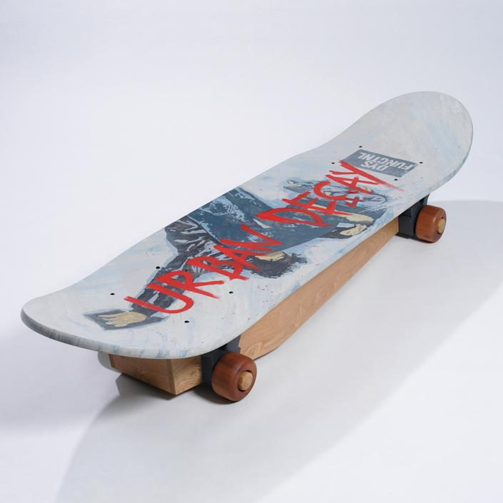 A coffin in the shape of a skateboard. (Photo: Caters News)